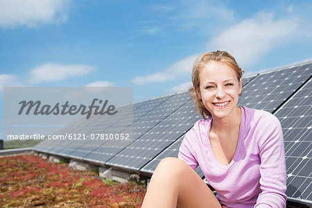 Teenage girl renewable energy solar panel Stock Photo - Premium Royalty-Free, Image code: 6121-07810052
