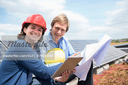 Solar energy park meeting architect client Stock Photo - Premium Royalty-Free, Image code: 6121-07810064