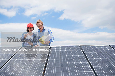Photovoltaic panel architect female client Stock Photo - Premium Royalty-Free, Image code: 6121-07810066