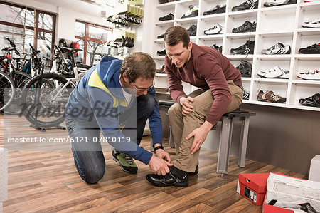 Man buying sports shoes Stock Photo - Premium Royalty-Free, Image code: 6121-07810119