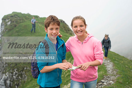 Portrait brother sister hiking in mountains Stock Photo - Premium Royalty-Free, Image code: 6121-07810252