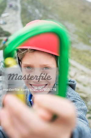 Young boy helmet holding climbing Carabiner Stock Photo - Premium Royalty-Free, Image code: 6121-07810278