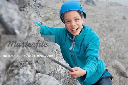 Young teenage boy helmet rope climbing safety Stock Photo - Premium Royalty-Free, Image code: 6121-07810289