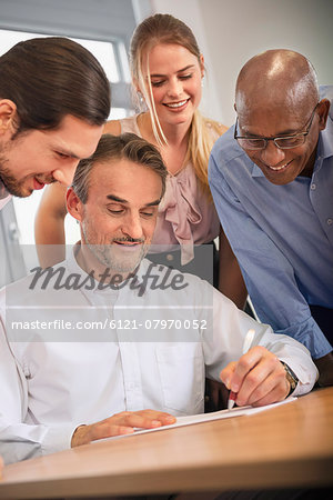 Team woman men office Brainstorming planning Stock Photo - Premium Royalty-Free, Image code: 6121-07970052