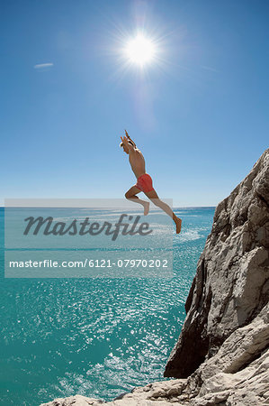 Teenager risk danger ocean holiday jump dive water Stock Photo - Premium Royalty-Free, Image code: 6121-07970202