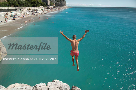 Boy holiday jump water ocean risk teenager Stock Photo - Premium Royalty-Free, Image code: 6121-07970203
