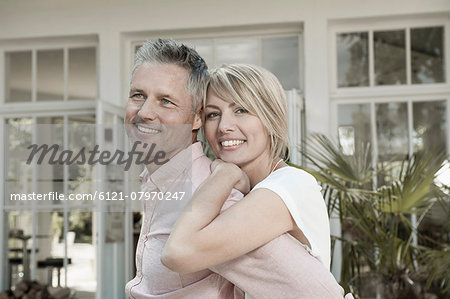 Couple married hugging garden portrait smiling Stock Photo - Premium Royalty-Free, Image code: 6121-07970247