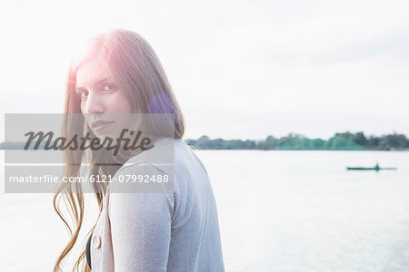 Portrait sunset attractive young woman Stock Photo - Premium Royalty-Free, Image code: 6121-07992488