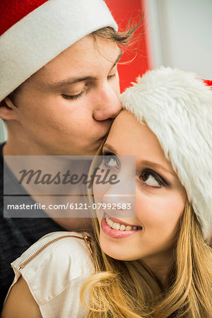 Young couple romancing on Christmas eve, Munich, Bavaria, Germany Stock Photo - Premium Royalty-Free, Image code: 6121-07992583