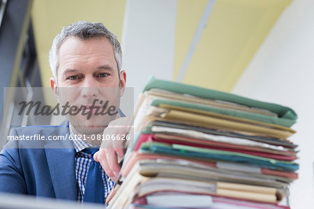 Businessman working in office, Leipzig, Saxony, Germany Stock Photo - Premium Royalty-Free, Image code: 6121-08106626