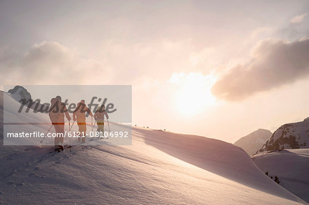 Ski mountaineers climbing on snowy mountain, Tyrol, Austria Stock Photo - Premium Royalty-Free, Image code: 6121-08106992