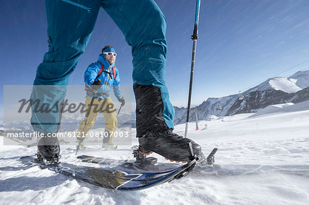 Ski mountaineers climbing on snowy mountain in snow storm, Zell Am See, Austria Stock Photo - Premium Royalty-Free, Image code: 6121-08107003