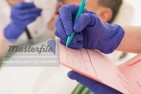 Dental assistant writing on index card, Munich, Bavaria, Germany Stock Photo - Premium Royalty-Free, Image code: 6121-08228455