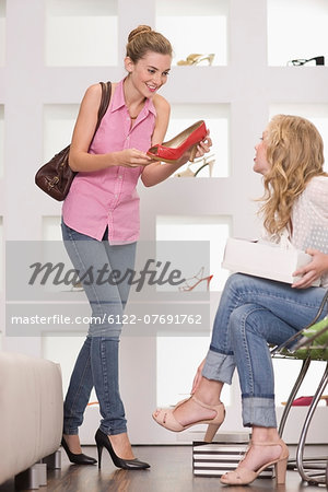 Girls in shoe shop Stock Photo - Premium Royalty-Free, Image code: 6122-07691762