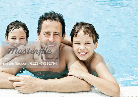 Father and 2 sons pool portrait Stock Photo - Premium Royalty-Free, Image code: 6122-07692794