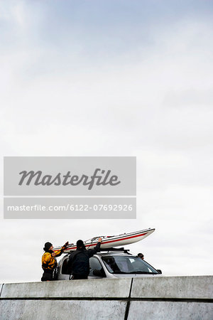 Unloading kayak Stock Photo - Premium Royalty-Free, Image code: 6122-07692926