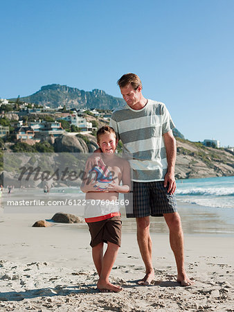 Father and son on a beach with ball Stock Photo - Premium Royalty-Free, Image code: 6122-07694569