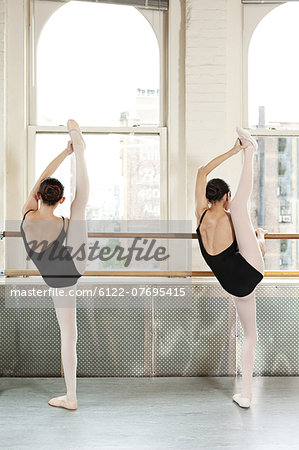 Rear view of ballerinas raising legs Stock Photo - Premium Royalty-Free, Image code: 6122-07695415
