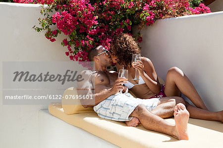 Relaxed couple kissing Stock Photo - Premium Royalty-Free, Image code: 6122-07695601