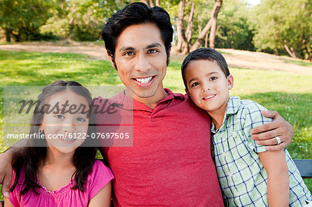 Man with son and daughter in park, portrait Stock Photo - Premium Royalty-Free, Image code: 6122-07697505