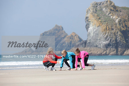 Family running together on beach Stock Photo - Premium Royalty-Free, Image code: 6122-07699278
