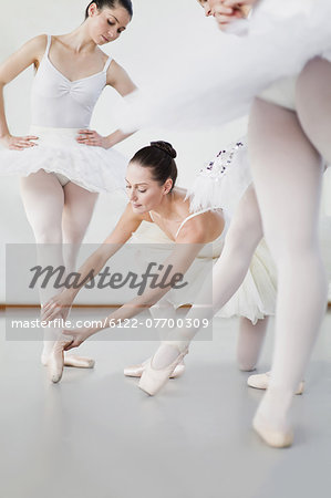 Ballet dancer adjusting colleague's pose Stock Photo - Premium Royalty-Free, Image code: 6122-07700309