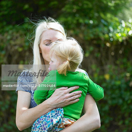 Mother kissing baby daughter Stock Photo - Premium Royalty-Free, Image code: 6122-07700604