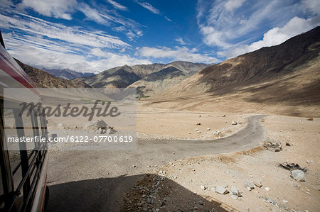 Rural road through desert and mountains Stock Photo - Premium Royalty-Free, Image code: 6122-07700619