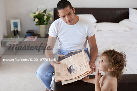 Father and son in bedroom Stock Photo - Premium Royalty-Free, Image code: 6122-07701115
