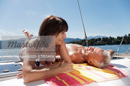 Older couple relaxing on sailboat Stock Photo - Premium Royalty-Free, Image code: 6122-07701406