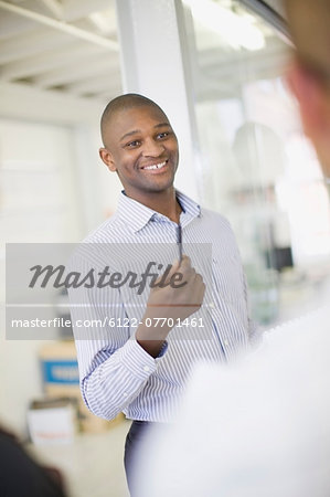 Businessman talking in office Stock Photo - Premium Royalty-Free, Image code: 6122-07701461