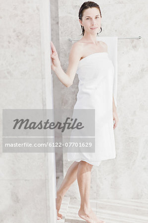 Woman wrapped in towel in bathroom Stock Photo - Premium Royalty-Free, Image code: 6122-07701629