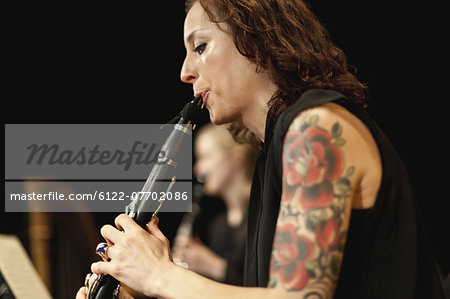 Clarinet player in orchestra Stock Photo - Premium Royalty-Free, Image code: 6122-07702086