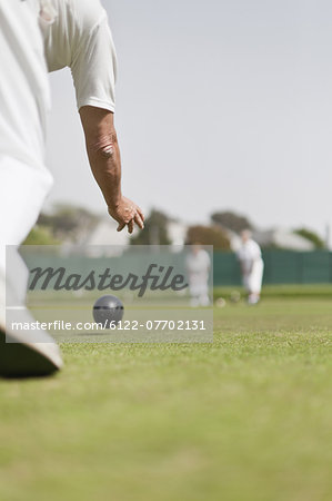 Older man lawn bowling Stock Photo - Premium Royalty-Free, Image code: 6122-07702131