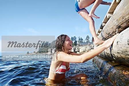 Teenage girls climbing pier Stock Photo - Premium Royalty-Free, Image code: 6122-07702225