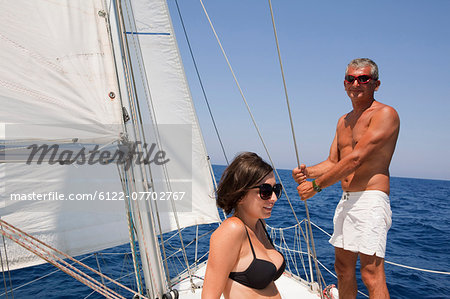 Older couple sailing on lake Stock Photo - Premium Royalty-Free, Image code: 6122-07702767