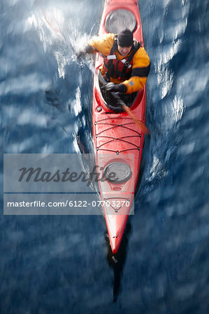 Aerial view of kayaker in water Stock Photo - Premium Royalty-Free, Image code: 6122-07703270