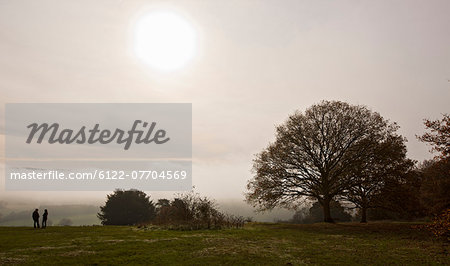 People standing in rural field Stock Photo - Premium Royalty-Free, Image code: 6122-07704569