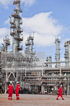 Workers talking at oil refinery Stock Photo - Premium Royalty-Free, Image code: 6122-07706269