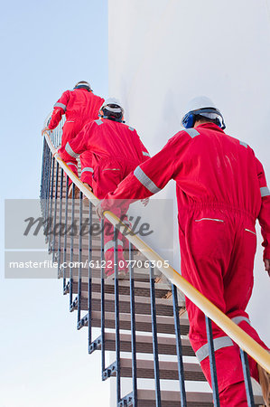 Workers on steps at chemical plant Stock Photo - Premium Royalty-Free, Image code: 6122-07706305