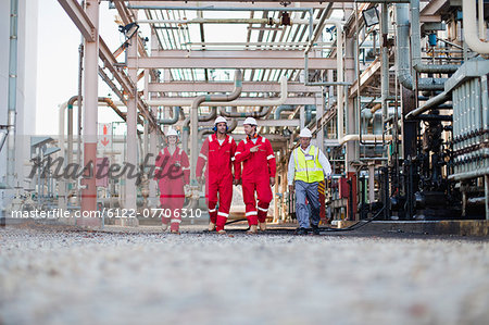 Workers walking at chemical plant Stock Photo - Premium Royalty-Free, Image code: 6122-07706310