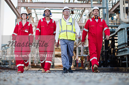 Workers walking at chemical plant Stock Photo - Premium Royalty-Free, Image code: 6122-07706311