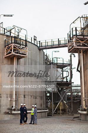 Workers talking at chemical plant Stock Photo - Premium Royalty-Free, Image code: 6122-07706317