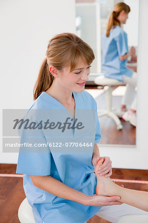 Doctor examining boys feet in office Stock Photo - Premium Royalty-Free, Image code: 6122-07706464