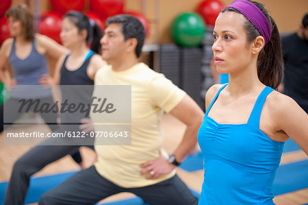 People practicing yoga in studio Stock Photo - Premium Royalty-Free, Image code: 6122-07706643