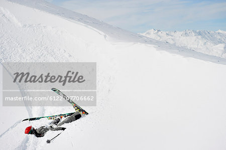 Skier doing flip on snowy slope Stock Photo - Premium Royalty-Free, Image code: 6122-07706662