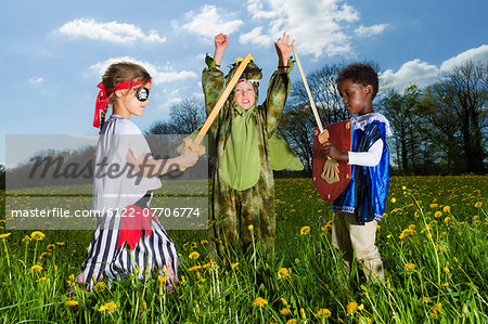 Boys playing dress up outdoors Stock Photo - Premium Royalty-Free, Image code: 6122-07706774