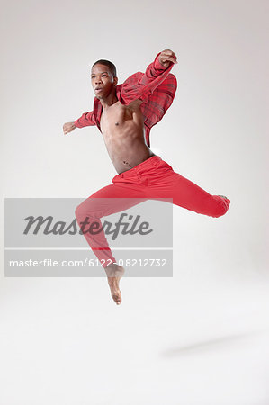 Young dancer in mid air Stock Photo - Premium Royalty-Free, Image code: 6122-08212732