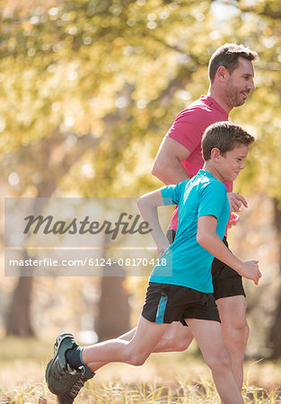 Father and son jogging in park Stock Photo - Premium Royalty-Free, Image code: 6124-08170418