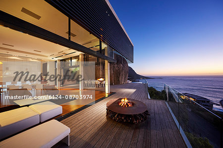 Fire pit on modern luxury home showcase beach house at sunset